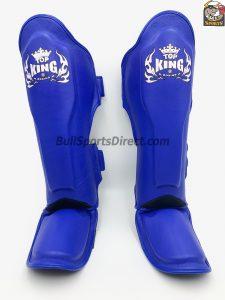 Front of blue pro Muay Thai shin pads semi leather