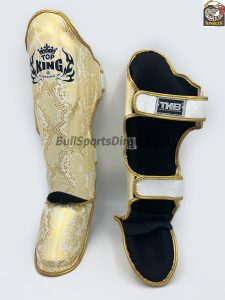 golden and white Pro Muay Thai shin pads Top King super snake
